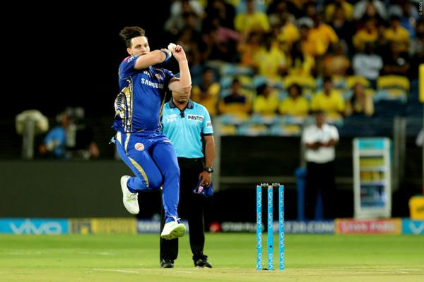 Beautiful image of Mitchell McClenaghan before the ball was thrown in the match.