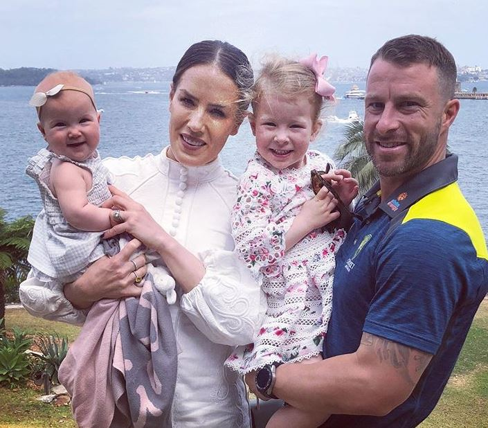 Matthew Wade with wife and daughters