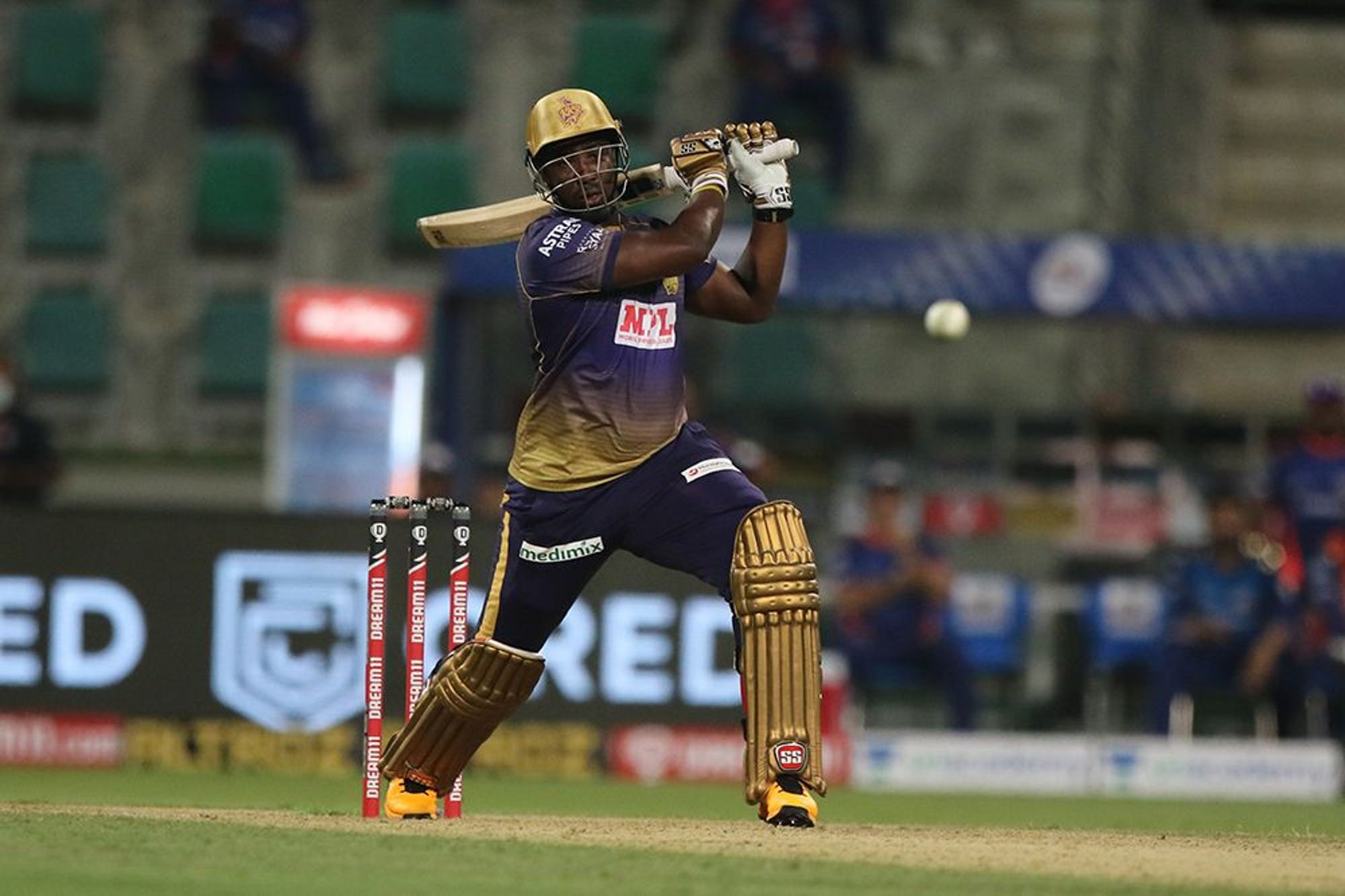 Andre Russell of Kolkata Knight Riders plays a shot during match KKR vs MI in Dream 11 IPL.