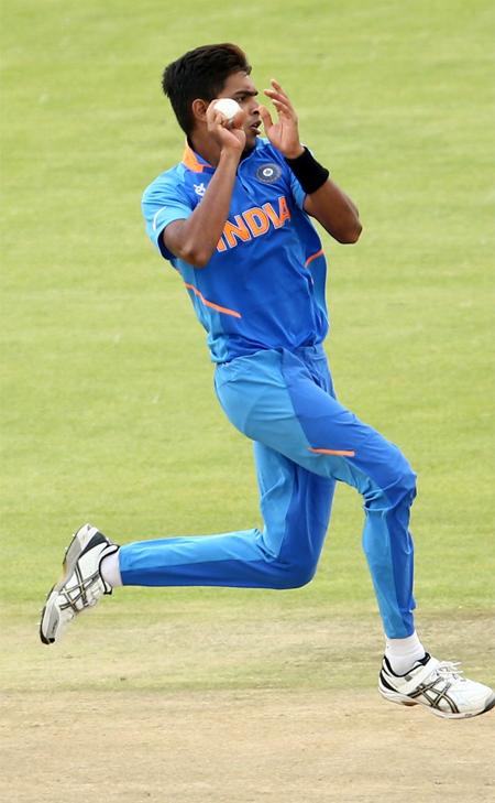 Kartik Tyagi bowling drawing in a match.